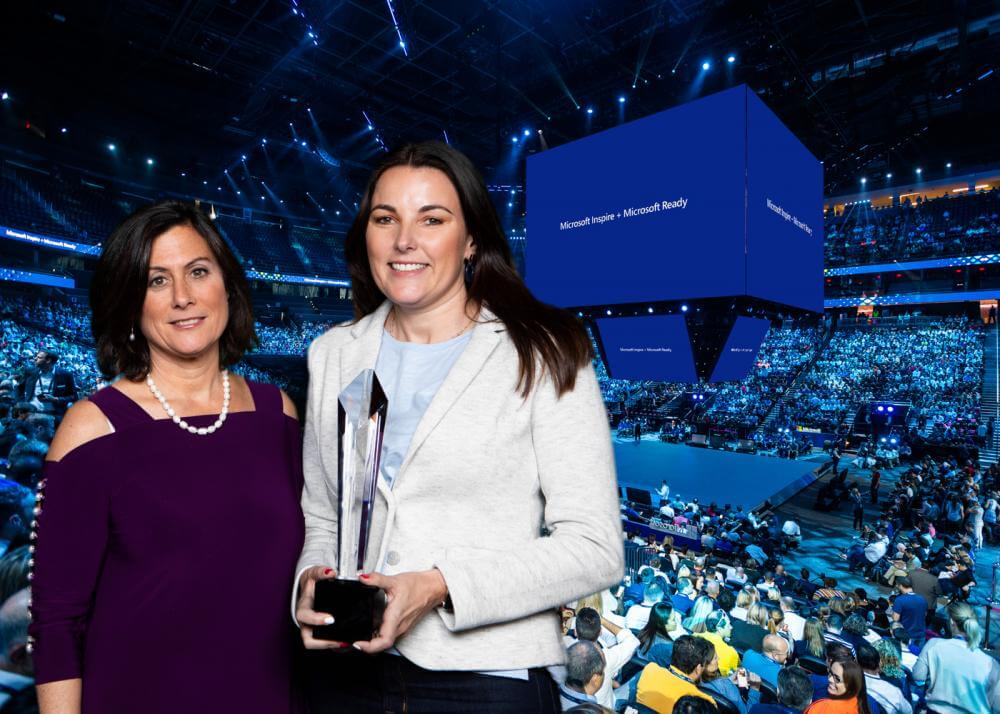 Vicky Critchley picking up the award with Microsoft's Gavriella Schuster at Microsoft Inspire in Las Vegas